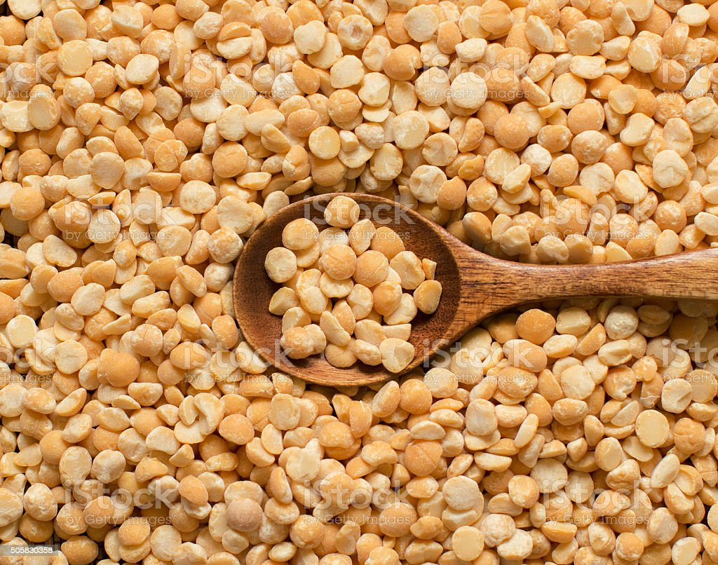Yellow peas with a spoon stock photo