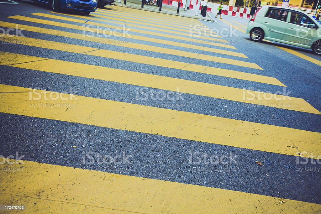 Yellow Pedestrian Crosswalk and Cars royalty-free stock photo
