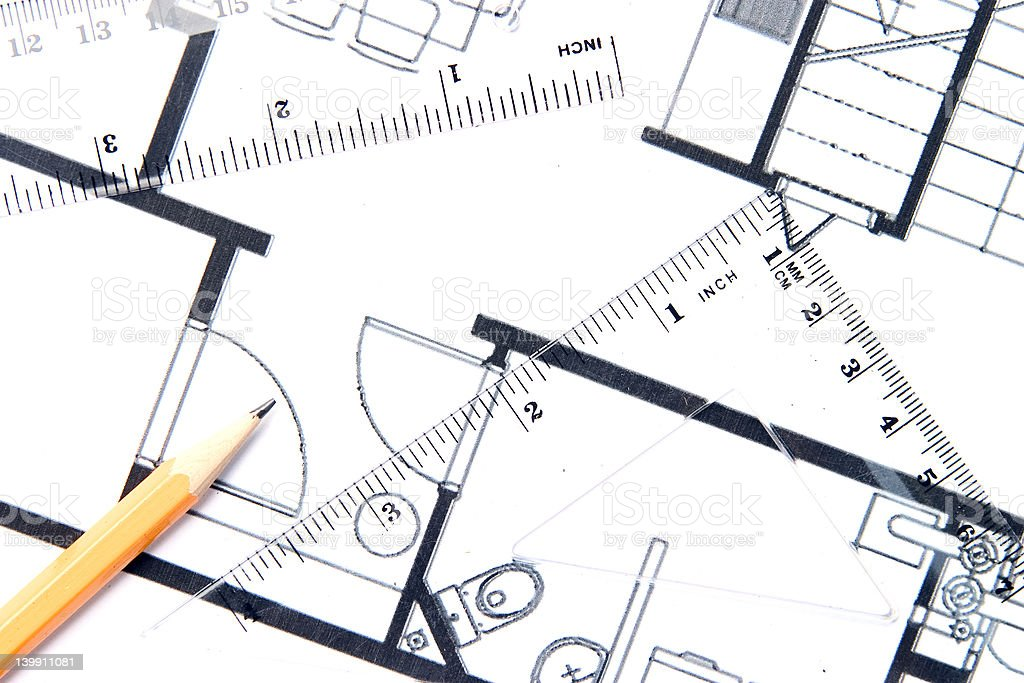 Yellow pencil and a floor plan stock photo