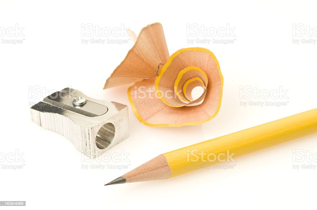 Yellow pencil and sharpener with shavings on white background stock photo