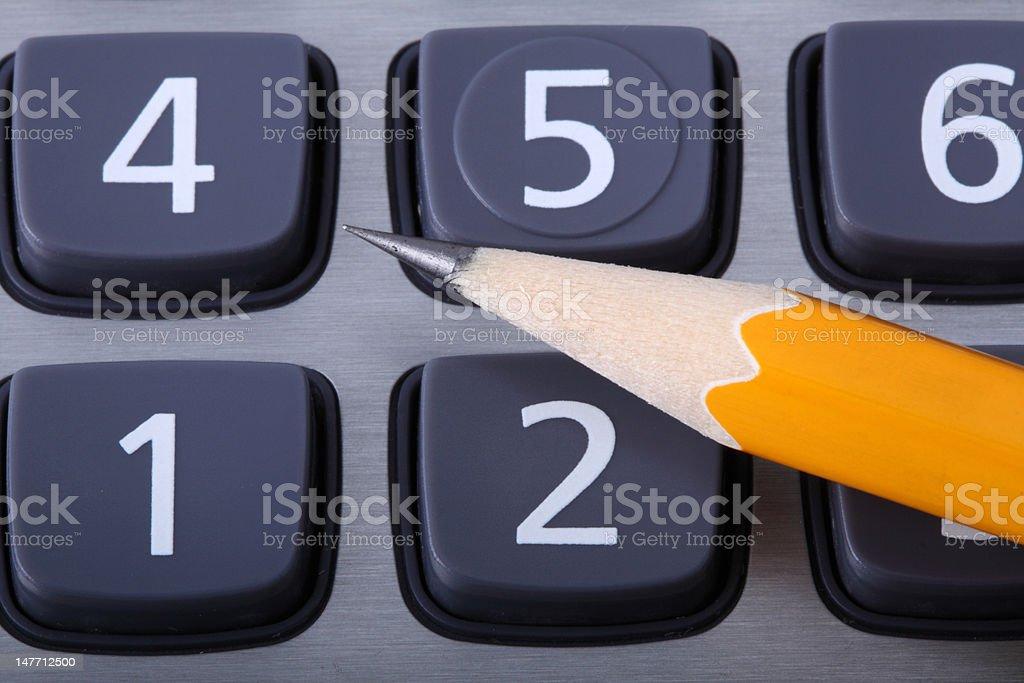 Yellow pencil on a keyboard stock photo