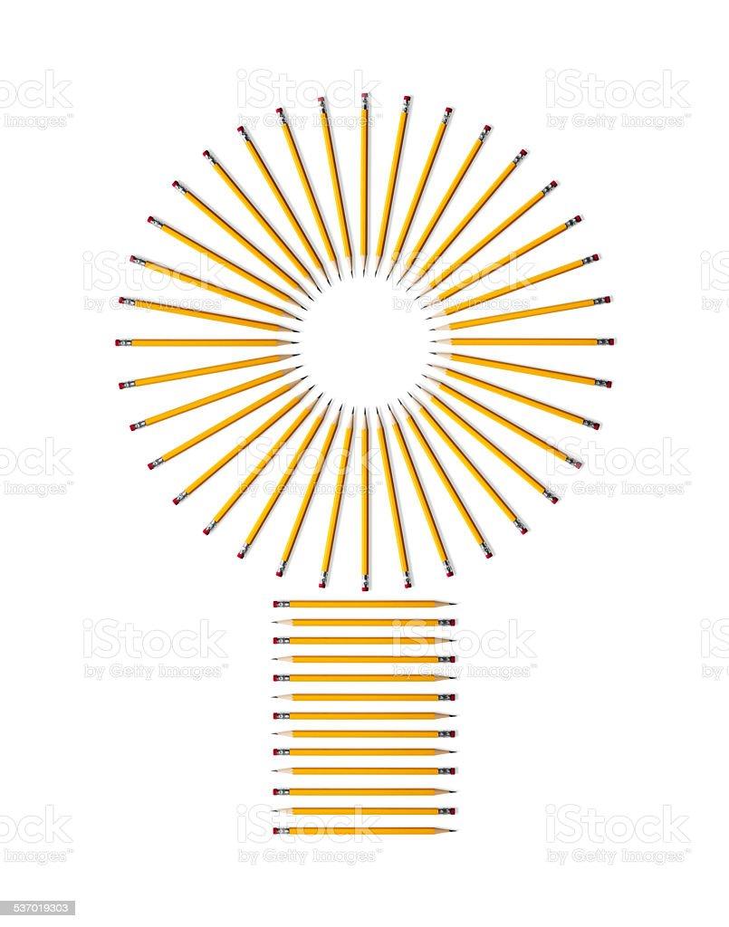 Yellow pencils form a lightbulb shape on white paper stock photo