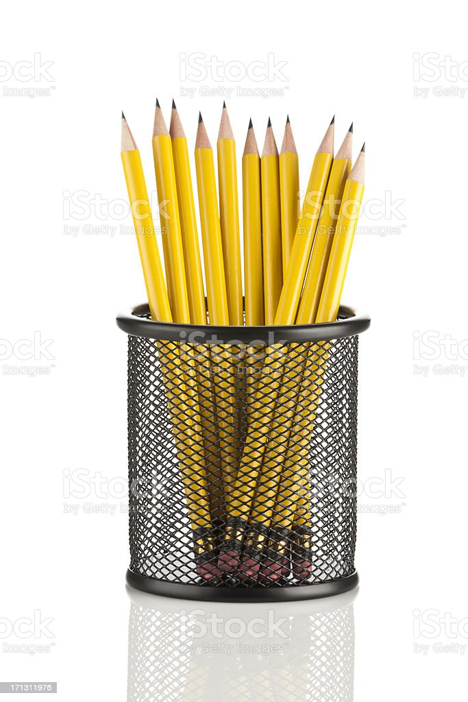 Yellow pencils in mesh pencil holder stock photo