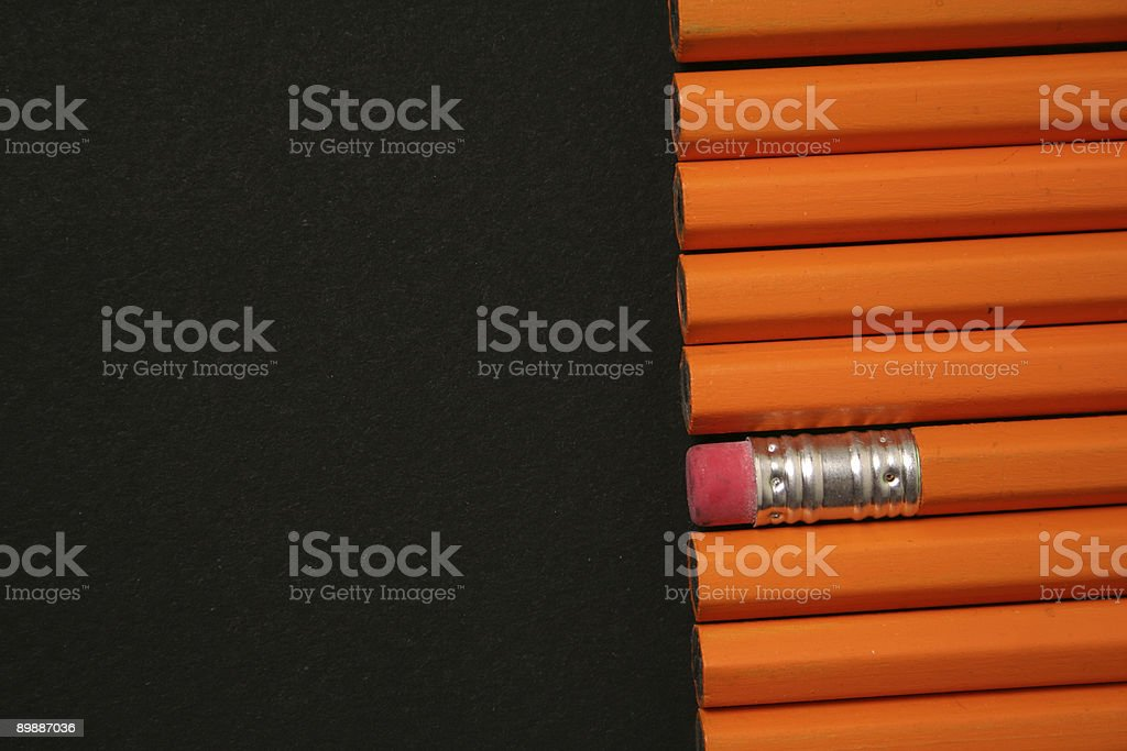 Yellow Pencils on black background royalty-free stock photo
