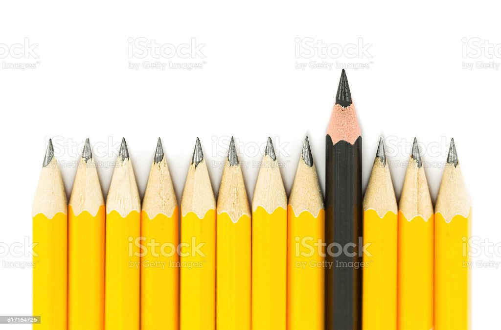 Yellow pencils with on black pencil on white background stock photo