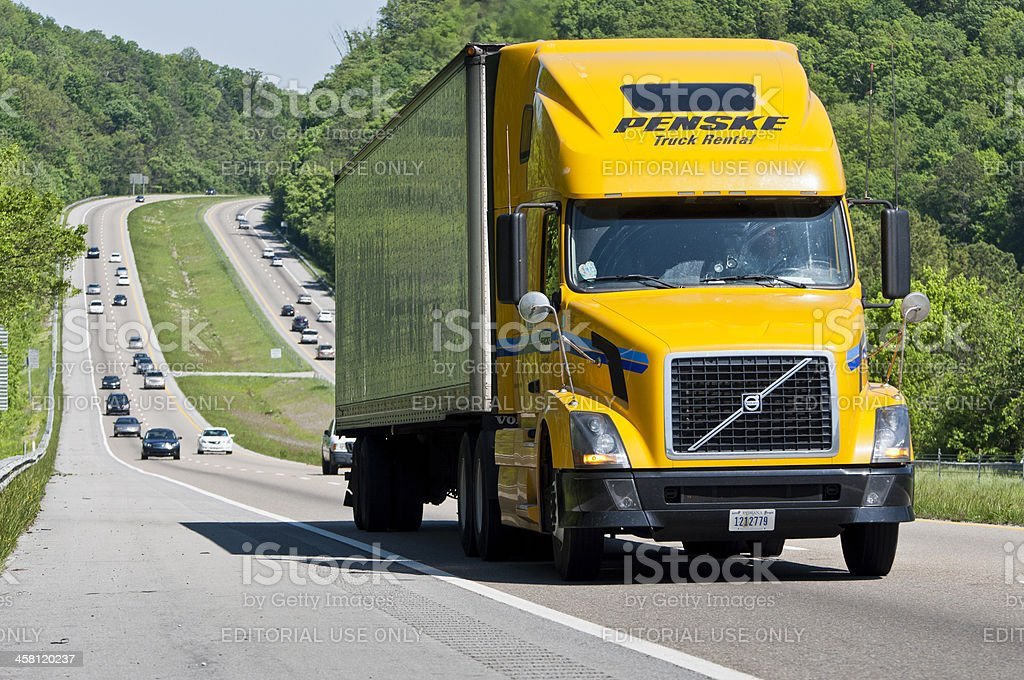 Yellow Penske Rental Truck Climbs Interstate Highway Hill stock photo