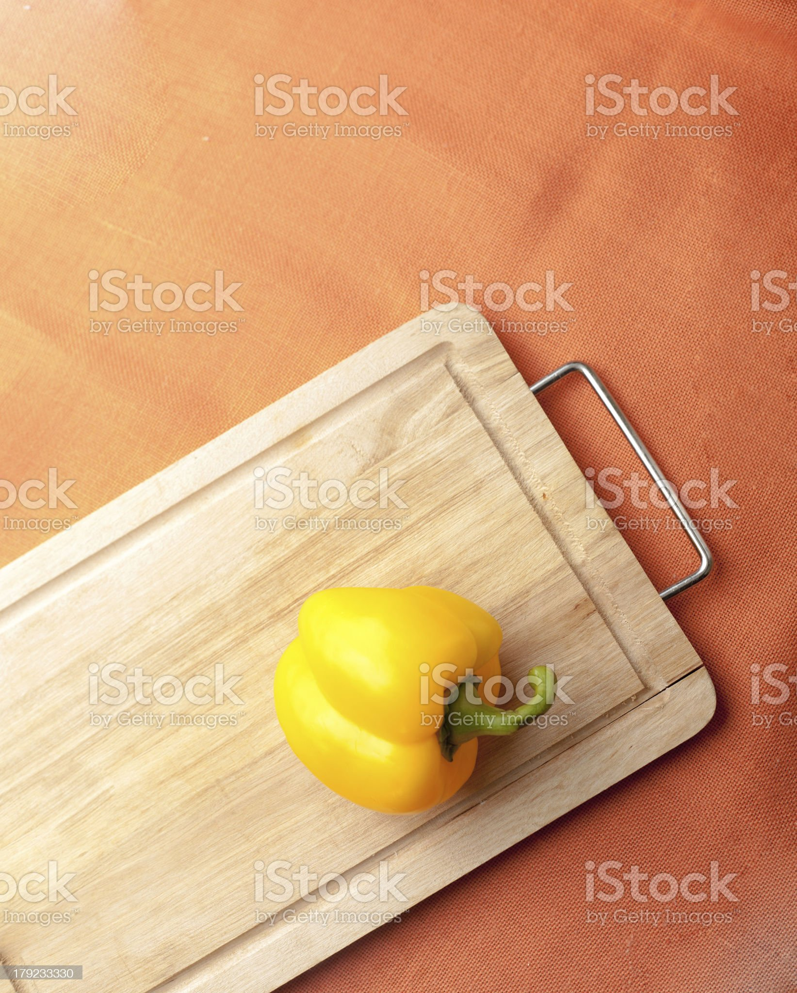 Yellow pepper  on a Wooden Background royalty-free stock photo
