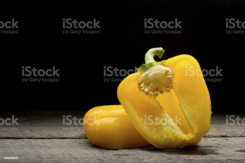 Yellow pepper on wood background royalty-free stock photo