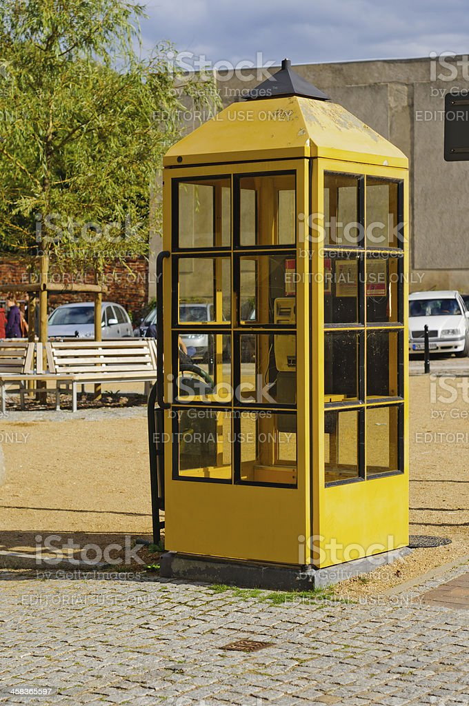 yellow phone booth stock photo
