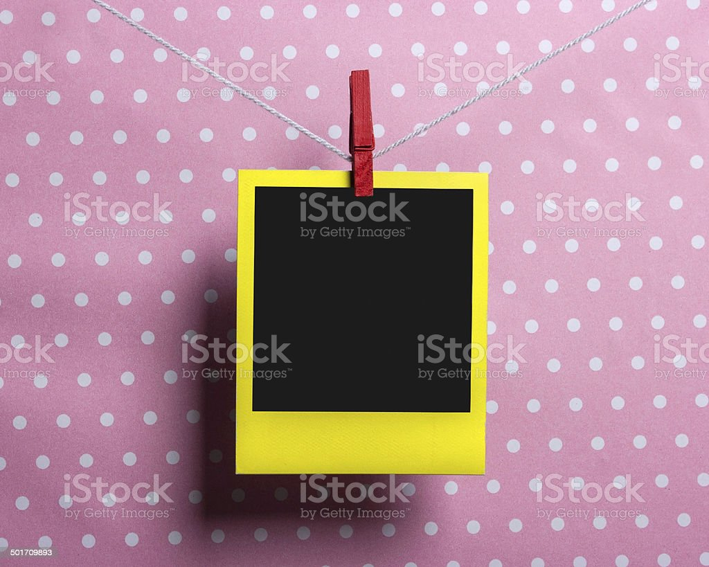 Yellow photo on a clothesline stock photo