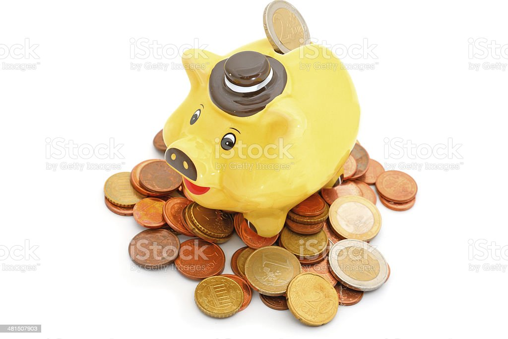 Yellow piggy bank on euro coins with white background stock photo