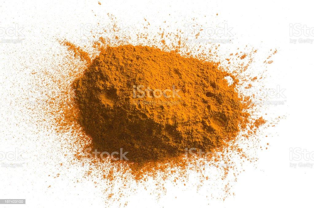 Yellow pile of pigment powder on white royalty-free stock photo