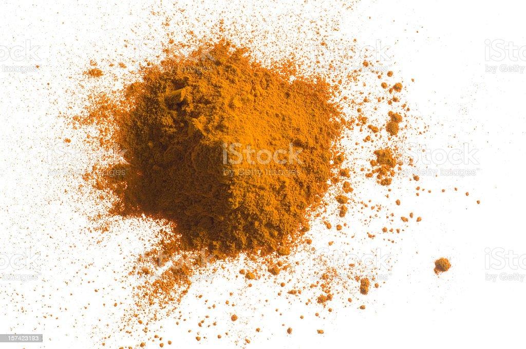 Yellow pile of pigment powder on white stock photo