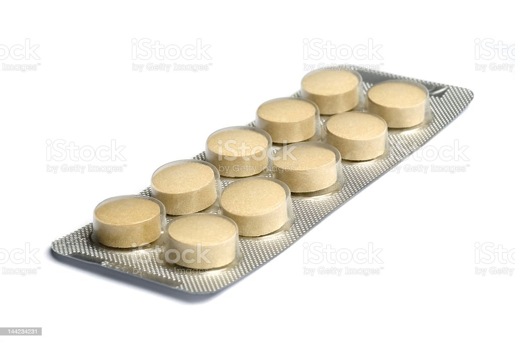 Yellow pills in package royalty-free stock photo