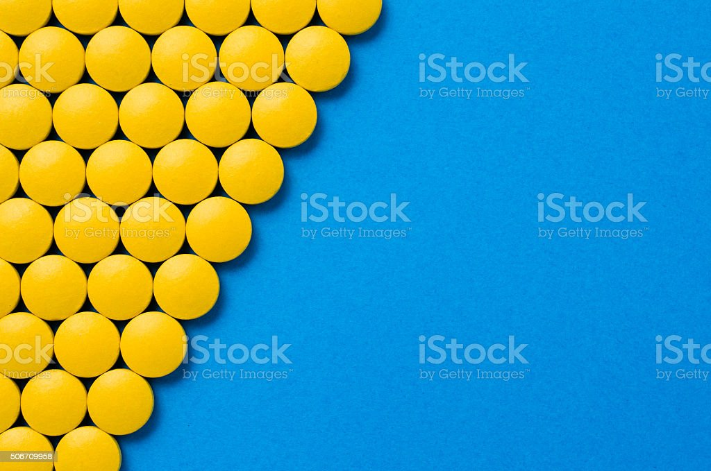 Yellow pills stock photo