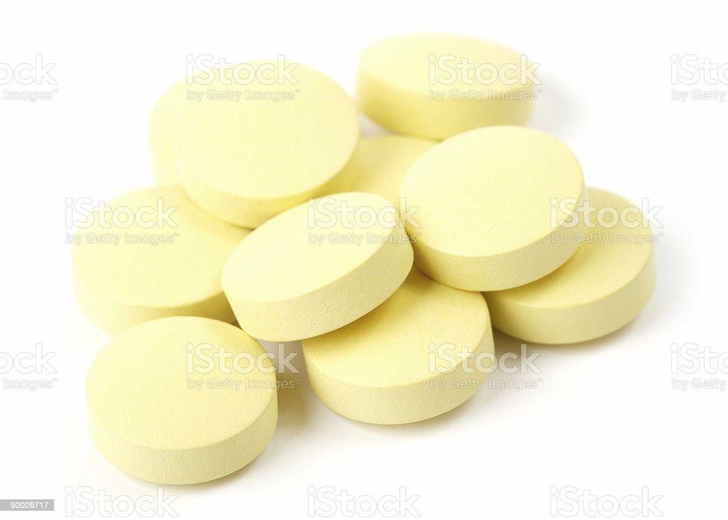 Yellow pills stock photo