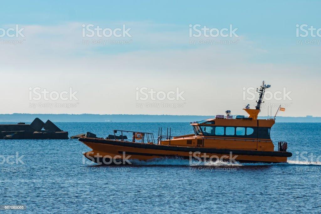 Yellow pilot ship stock photo