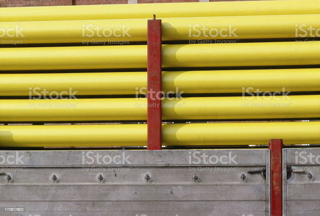 yellow pipes on a truck stock photo