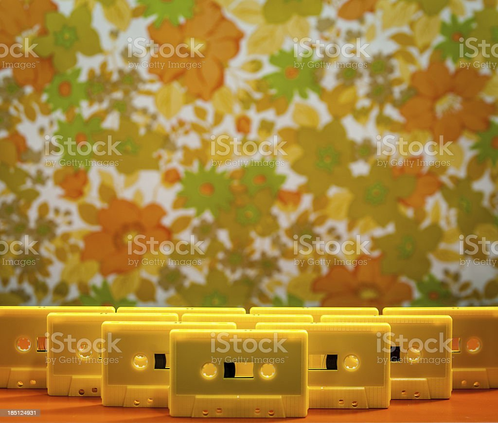 Yellow Plastic Cassette Tapes Arranged Standing Upright royalty-free stock photo