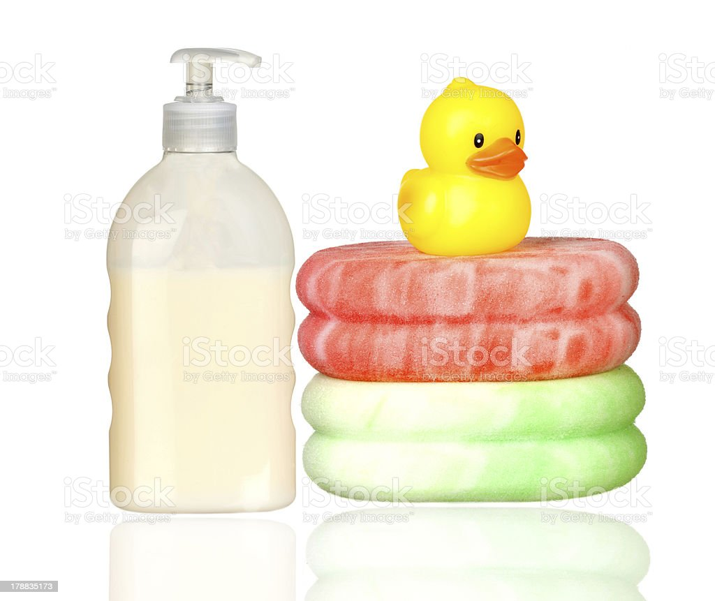 Yellow plastic duck over sponges and boat bath dispenser isolate royalty-free stock photo
