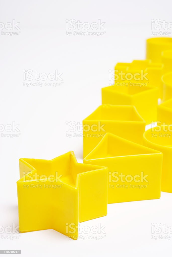 Yellow Plastic Geometric Shapes royalty-free stock photo