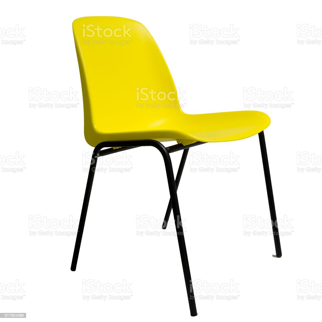 Yellow plastic stackable chair, isolated on white. stock photo