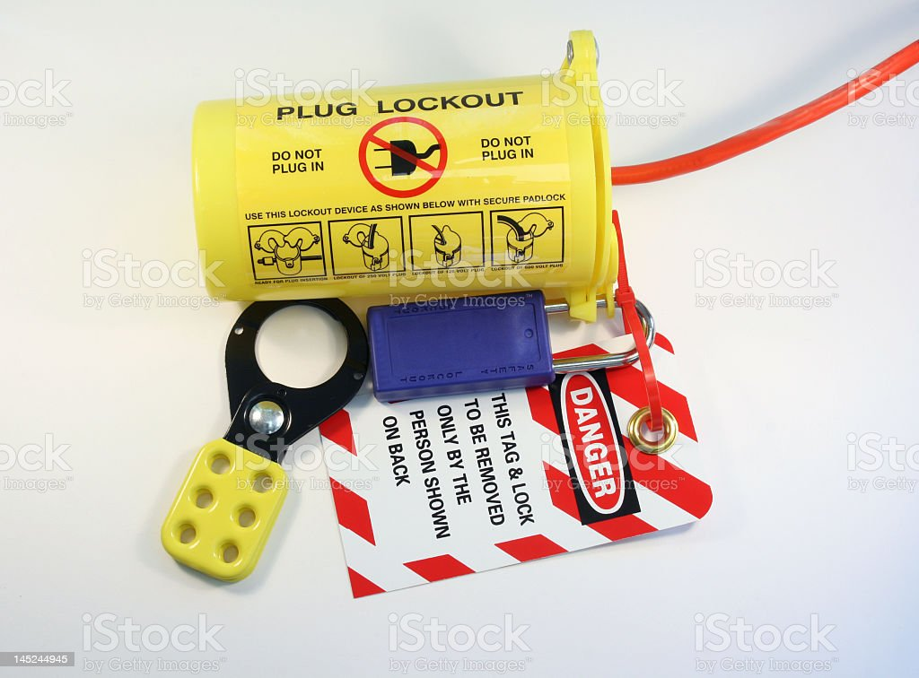 Yellow plug lockout system with danger warning instructions stock photo