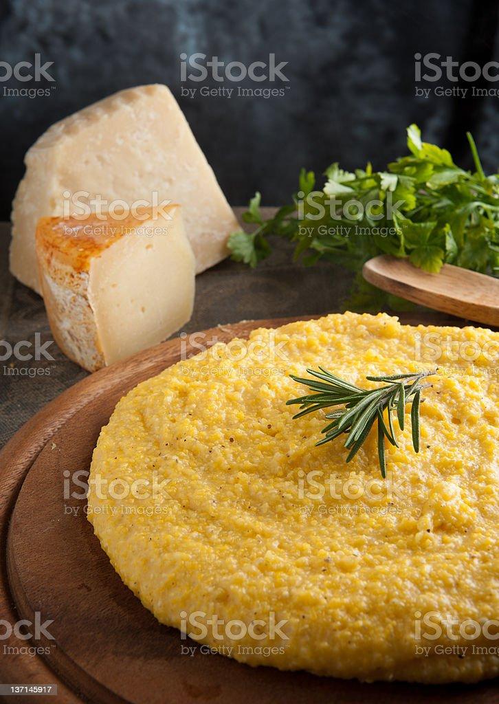 Yellow polenta on wooden table stock photo