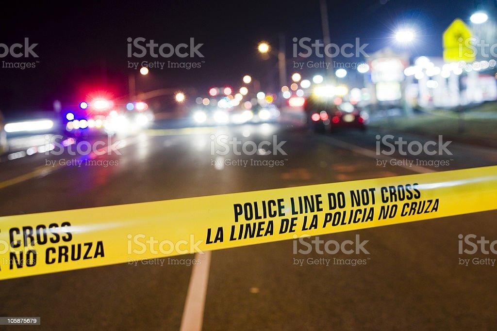 Yellow police line blocking off crime scene investigation stock photo