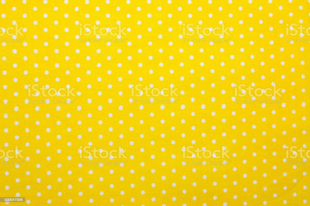 yellow polka dot fabric stock photo