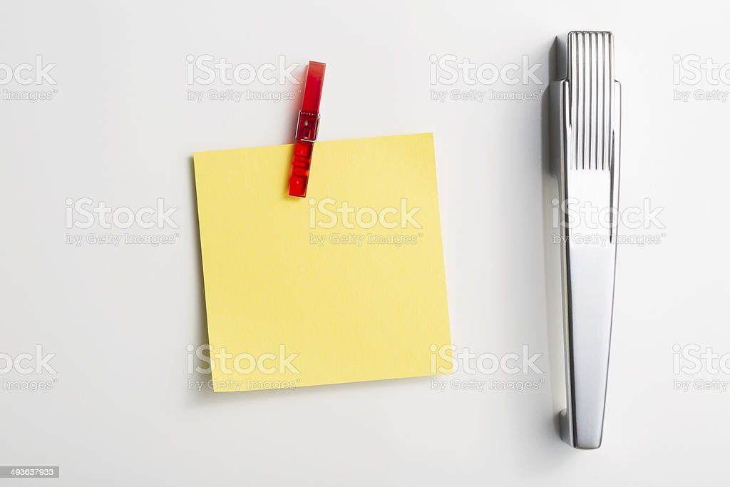 Yellow post it note in peg style fridge magnet stock photo