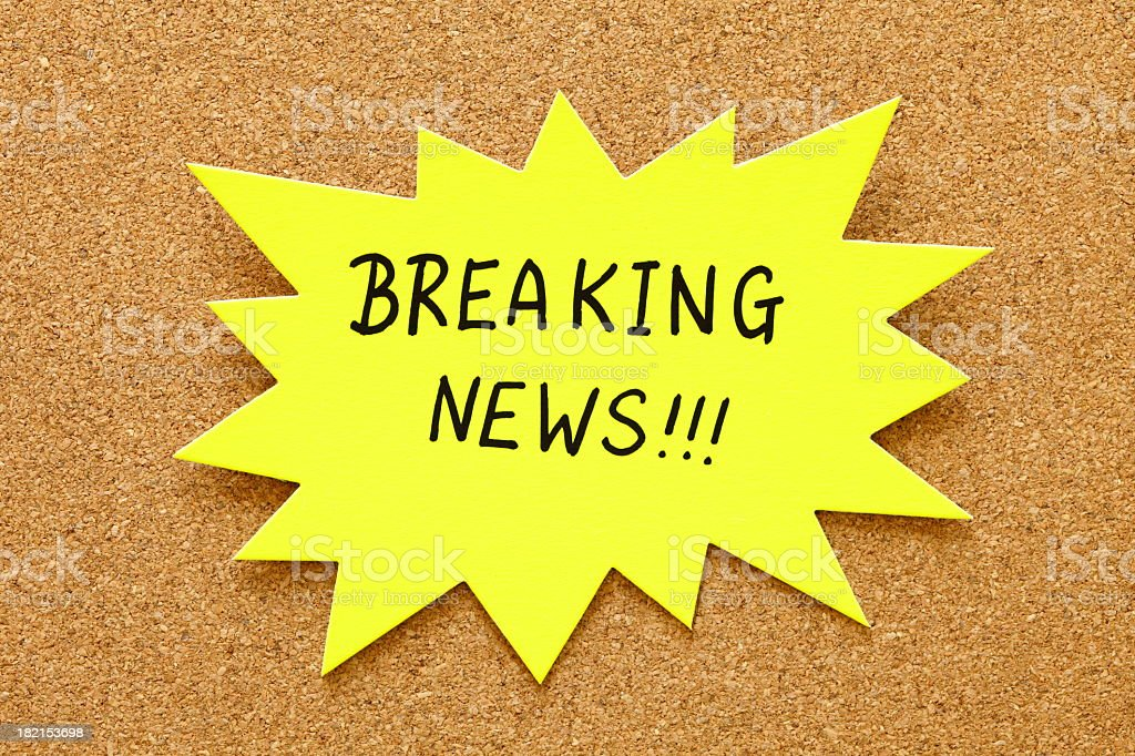 A yellow post it that says breaking news royalty-free stock photo