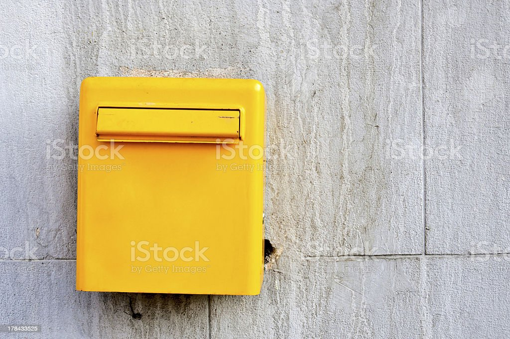 Yellow postbox royalty-free stock photo