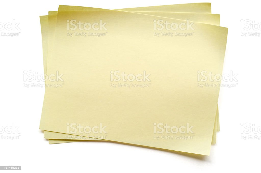 Yellow Post-it Note on Stack stock photo