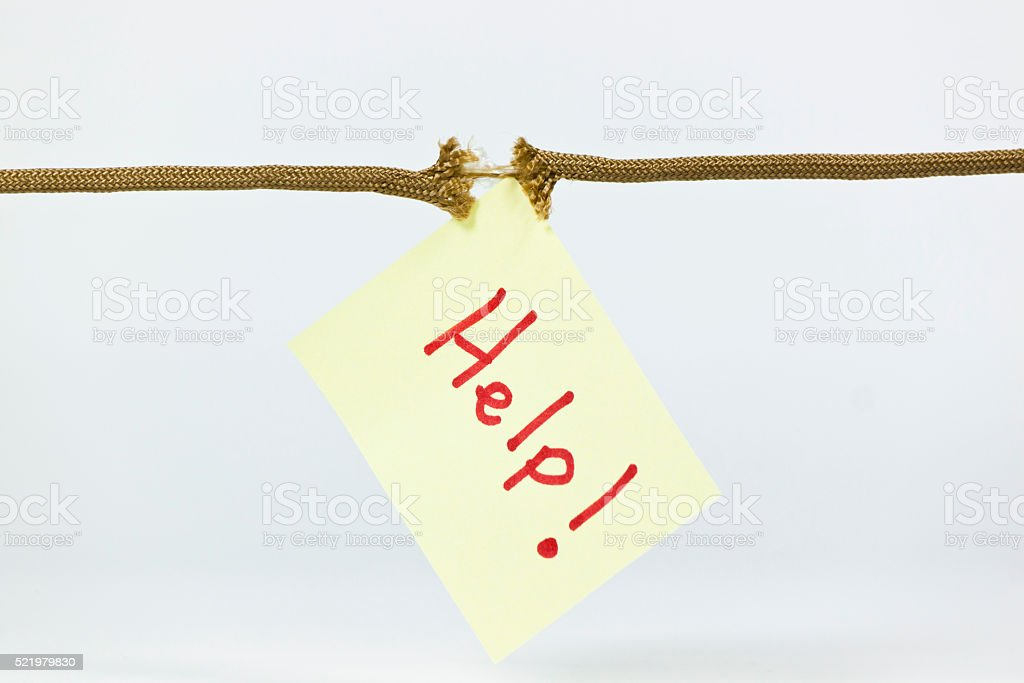 Yellow Post-It Note with the word HELP hanging a rope stock photo