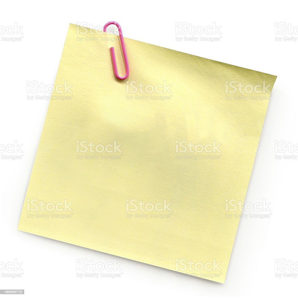 Yellow Post-it with paperclip royalty-free stock photo