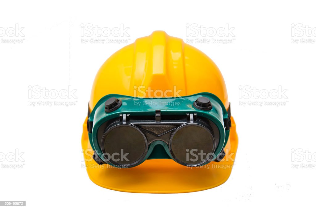 Yellow protective helmet and safety glasses isolated on white stock photo