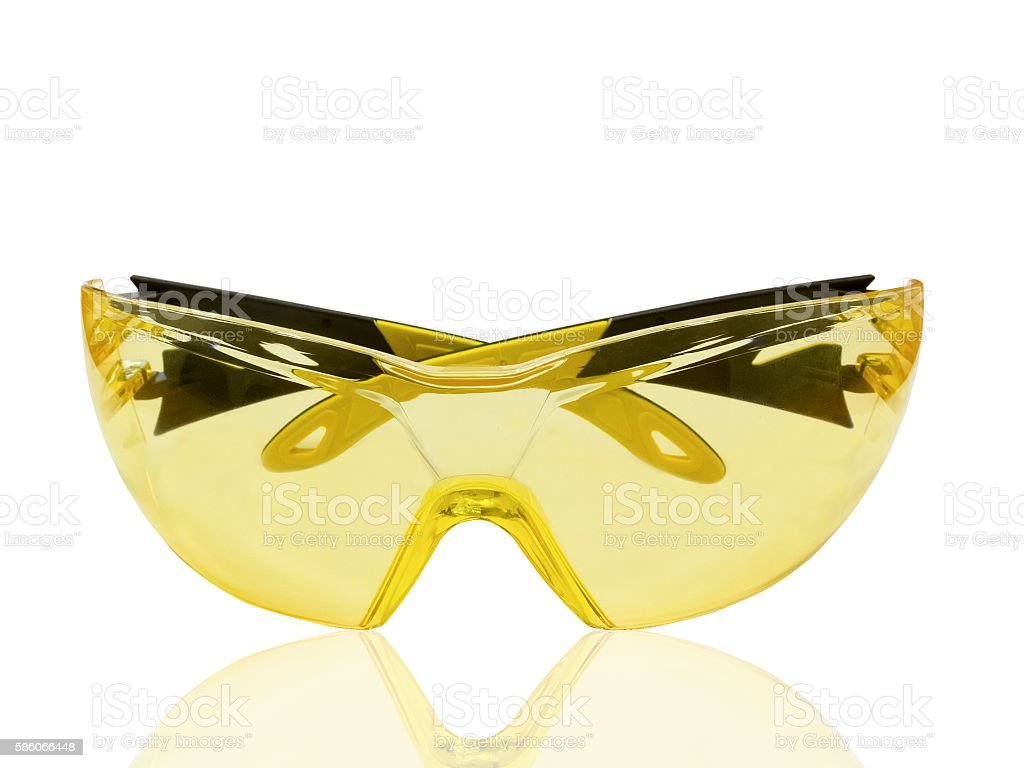Yellow protective spectacles stock photo