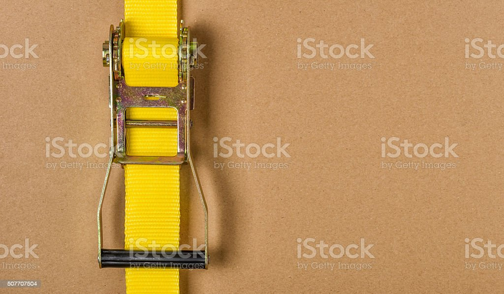 Yellow ratchet strap with copy space stock photo