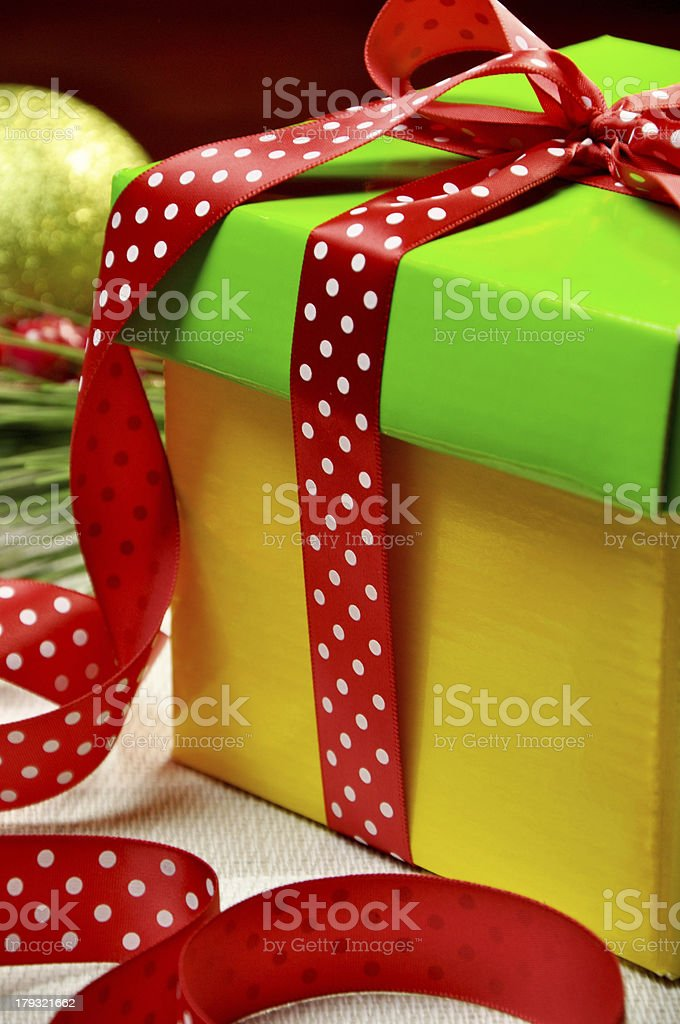 Yellow, red and green festive holiday present gift royalty-free stock photo