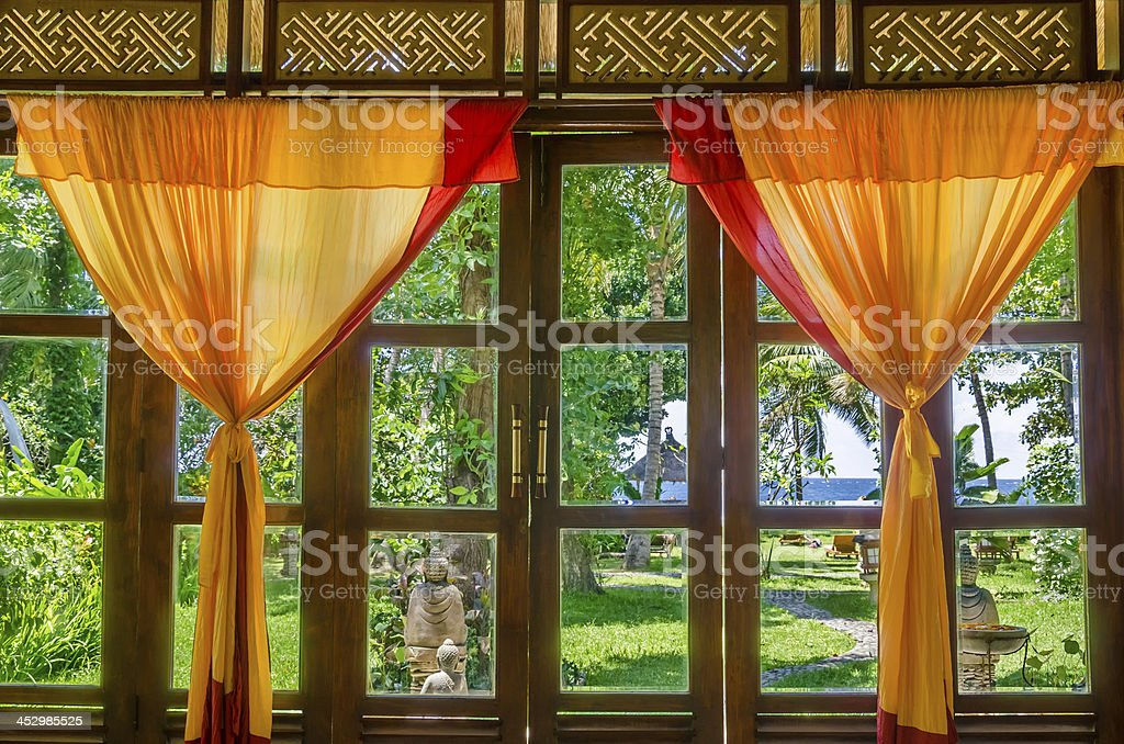 yellow red curtains at a window stock photo