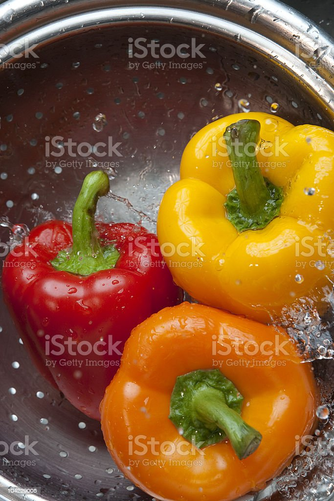 Yellow Red Orange Bell Pepper with Water Splash stock photo
