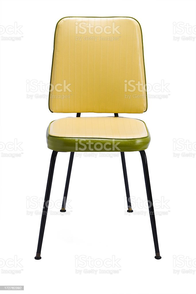 A yellow retro chair on a white background royalty-free stock photo