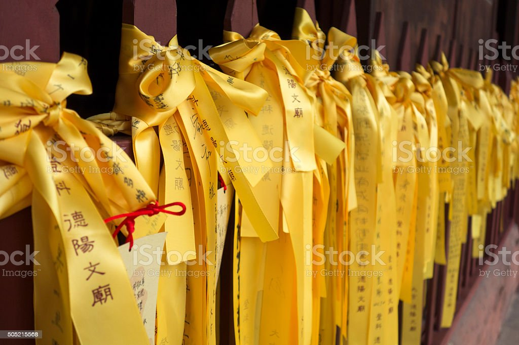 Yellow ribbons with wishes stock photo
