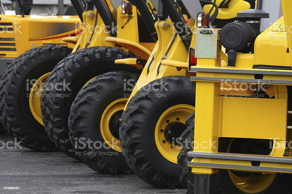 Yellow road construction vehicles stock photo