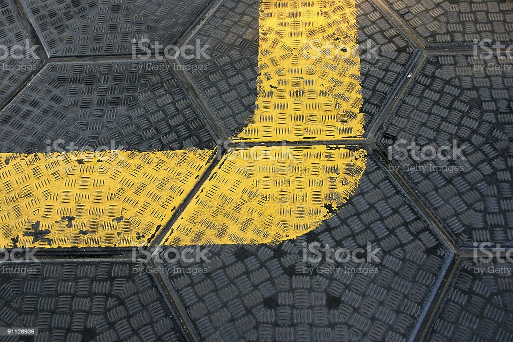 Yellow road mark sign on the sidewalk royalty-free stock photo