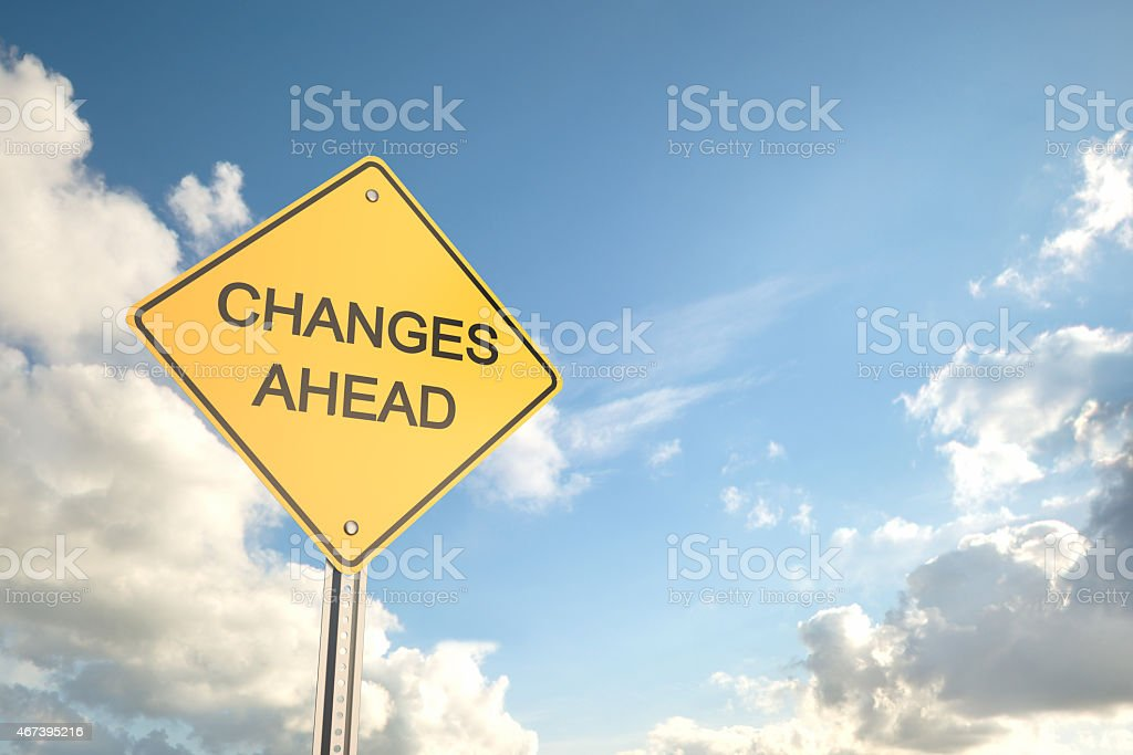 Yellow road sign saying changes ahead with blue cloudy sky stock photo