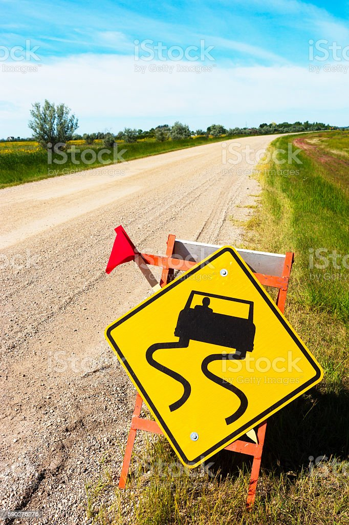 Yellow Road Sign Warning of Loose Gravel stock photo
