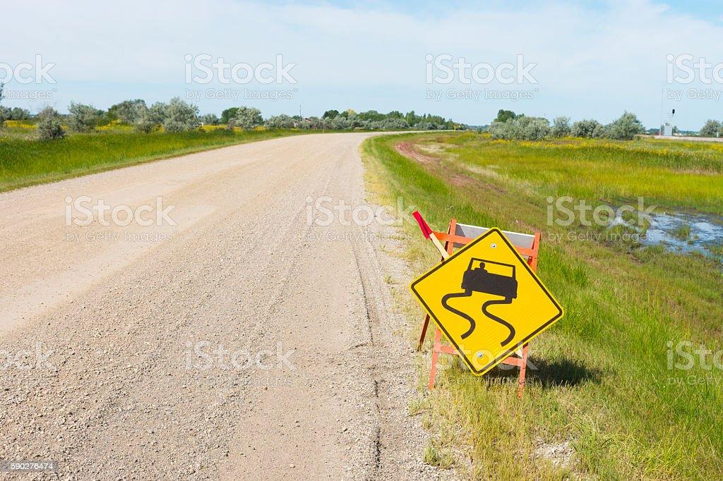 Yellow Road Sign Warning of Loose Gravel stock photo