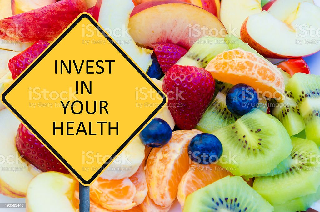 Yellow roadsign with message INVEST IN YOUR HEALTH stock photo